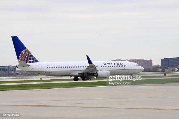 United Airlines airplane taxis up the runway to prepare for takeoff at O'Hare International Airport in Chicago Illinois on OCTOBER 25 2012