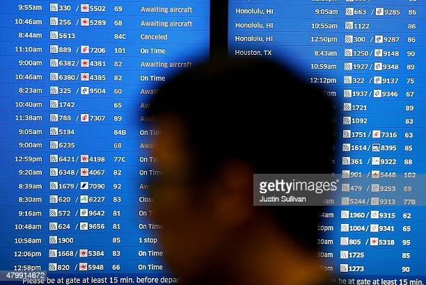 United Airlines are listed on a monitor at San Francisco International Airport on July 8 2015 in San Francisco California Thousands of United...