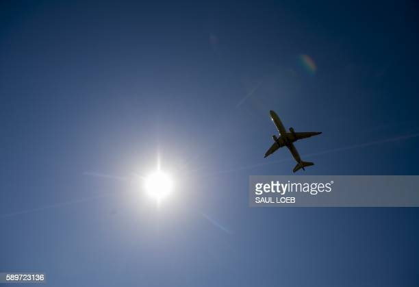 A United Airlines Boeing 737 airplane takes off from Ronald Reagan Washington National Airport in Arlington Virginia August 15 2016 / AFP / SAUL LOEB