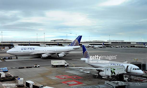 United Airlines Boeing 747 aircraft is pulled to the taxiway as another United Airlines jet is serviced at the gate at San Francisco International...