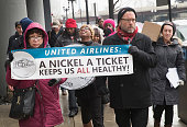 United Airlines catering workers protest against high healthcare cost during a demonstration in the Loop on January 29 2015 in Chicago Illinois The...