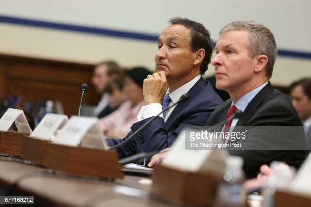 United Airlines CEO Oscar Munoz left accompanied by United Airlines President Scott Kirby testifies on Capitol Hill in Washington Tuesday May 2 to...
