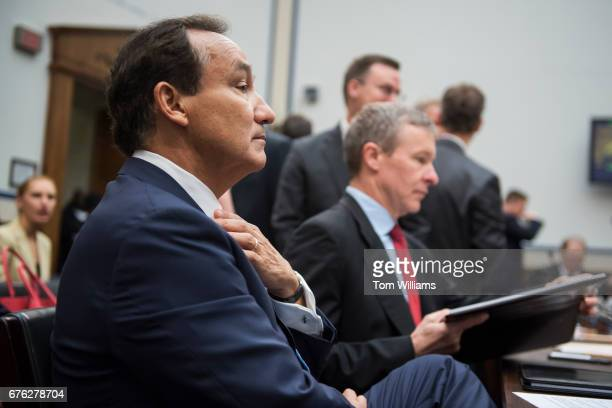 United Airlines CEO Oscar Munoz left and president Scott Kirby prepare to testify before a House Transportation and Infrastructure Committee hearing...