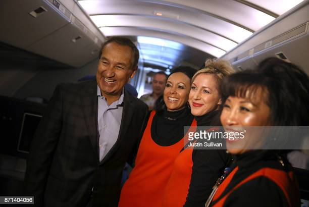 United Airlines CEO Oscar Munoz take a photo with flight attendants aboard United Airlines flight 747 before it takes off on its final flight from...