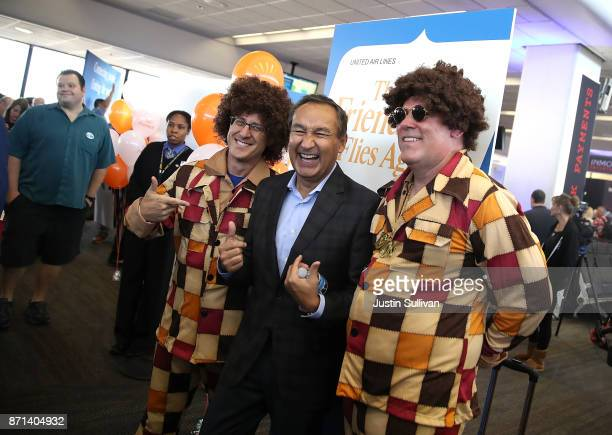 United Airlines CEO Oscar Munoz takes a picture with passengers dressed in retro clothing before United Airlines flight 747 takes off on its final...