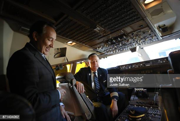 United Airlines CEO Oscar Munoz talks with United Airlines captain Tom Spratt aboard United Airlines flight 747 before it takes off on its final...