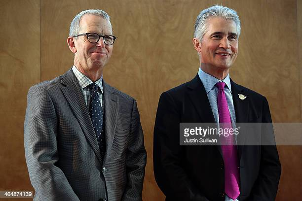 United Airlines Chairman President and CEO Jeff Smisek stands with San Francisco International Airport director John Martin during a news conference...