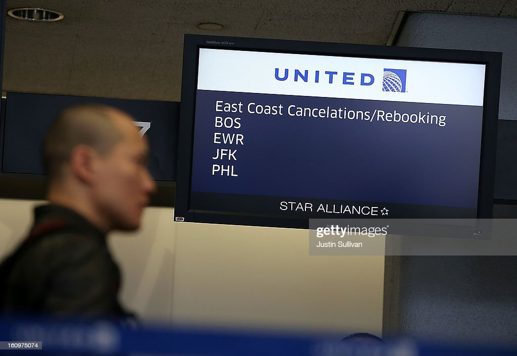 A United Airlines customer lines up to rebook a flight that was canceled due to weather on February 8, 2013 in San Francisco, California. Thousands of flights to the East Coast were canceled as a potentially historic blizzard is set to dump up to three feet of snow in the Northeast from New York City to Boston.
