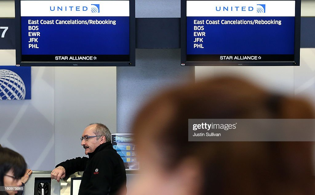 A United Airlines customer lines up to rebook a flight that was canceled due to weather at San Francisco International Airport on February 8, 2013 in San Francisco, California. Thousands of flights to the East Coast were canceled as a potentially historic blizzard is set to dump up to three feet of snow in the Northeast from New York City to Boston.