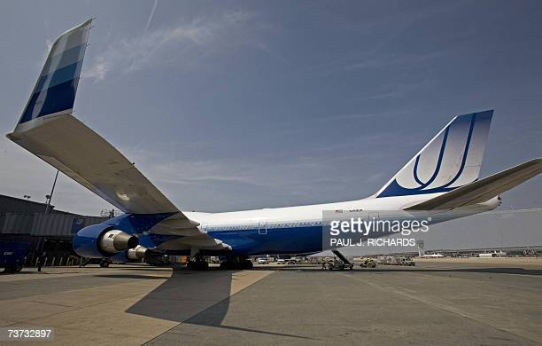 United Airlines flight a Boeing 747 at Washington DC's Dulles International Airport waits for it's maiden nonstop 13hour flight from WashingtonDC to...