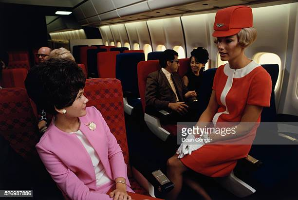 A United Airlines flight attendant talks with a passenger in a simulated passenger compartment of a Douglas DC10