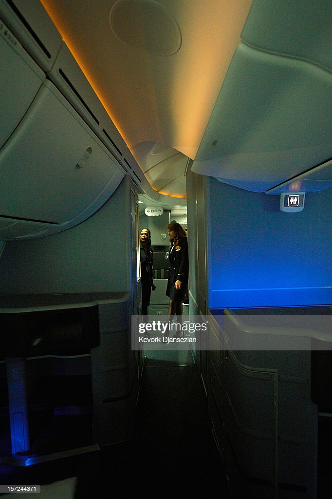 United Airlines flight attendants look at the LED cabin lighting as it changes colors on the United Airlines Boeing 787 Dreamliner at Los Angeles International Airport on November 30, 2012 in Los Angeles, California. In January the new jet is scheduled to begin flying daily non-stop between Los Angeles International airport and Japan's Narita International Airport and later to Shanghai staring in March. The new Boeing 787 Dreamliner will accommodate 219 travelers with 36 seat in United Business First, 70 seats in Economy Plus and 113 in Economy Class. The carbon-fiber composite material that makes up more than 50 percent of the 787 makes the plane jet and more fuel-efficient.