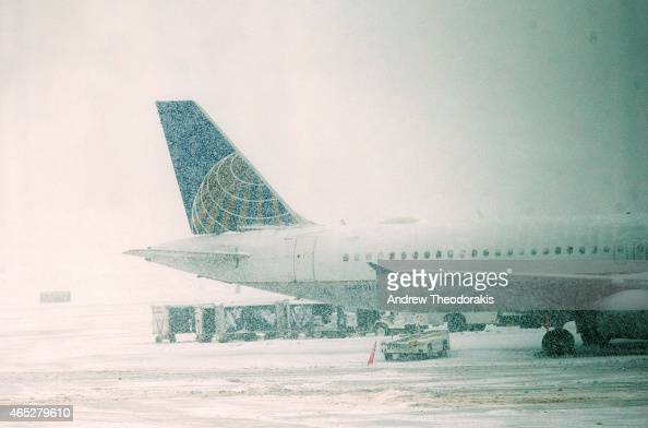 United Airlines jet sits on the tarmac March 5 2015 at LaGuardia Airport in the Queens borough of New York City A Delta jet partially skidded off a...