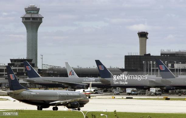 United Airlines jet taxis along a runway at O'Hare International Airport wait in line near the ticket counters October 5 2006 in Chicago Illinois...