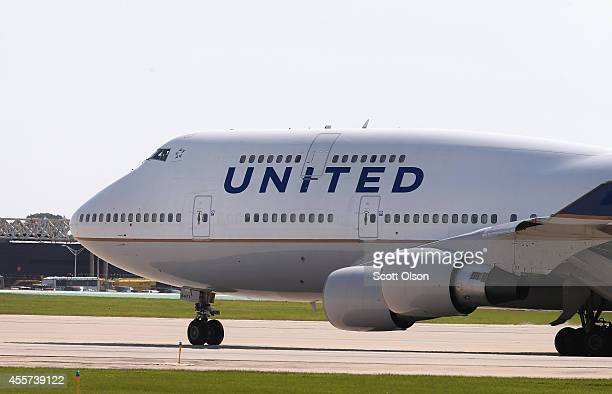 United Airlines jet taxis at O'Hare International Airport on September 19 2014 in Chicago Illinois In 2013 67 million passengers passed through...