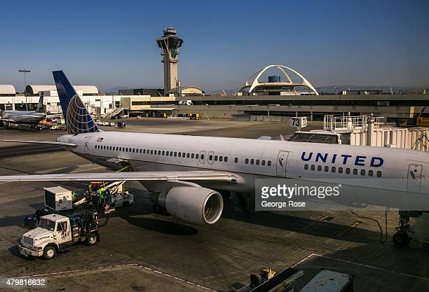 United Airlines jet unloads passengers at Los Angeles International Airport Terminal 7 on June 27 2015 in Los Angeles California Los Angeles...