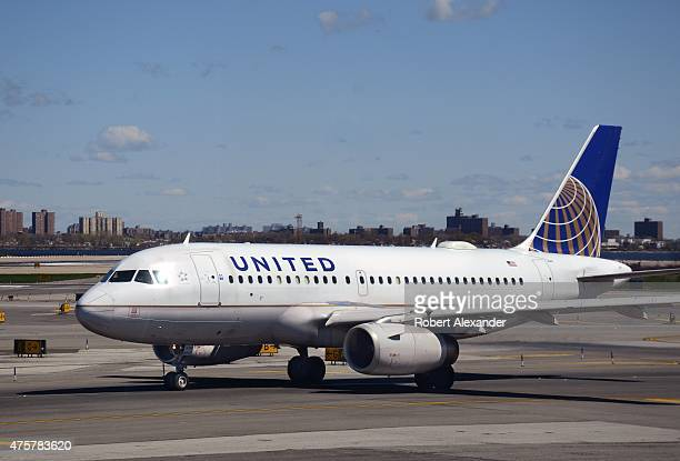 United Airlines passenger aircraft taxis at LaGuardia Airport in New York City New York