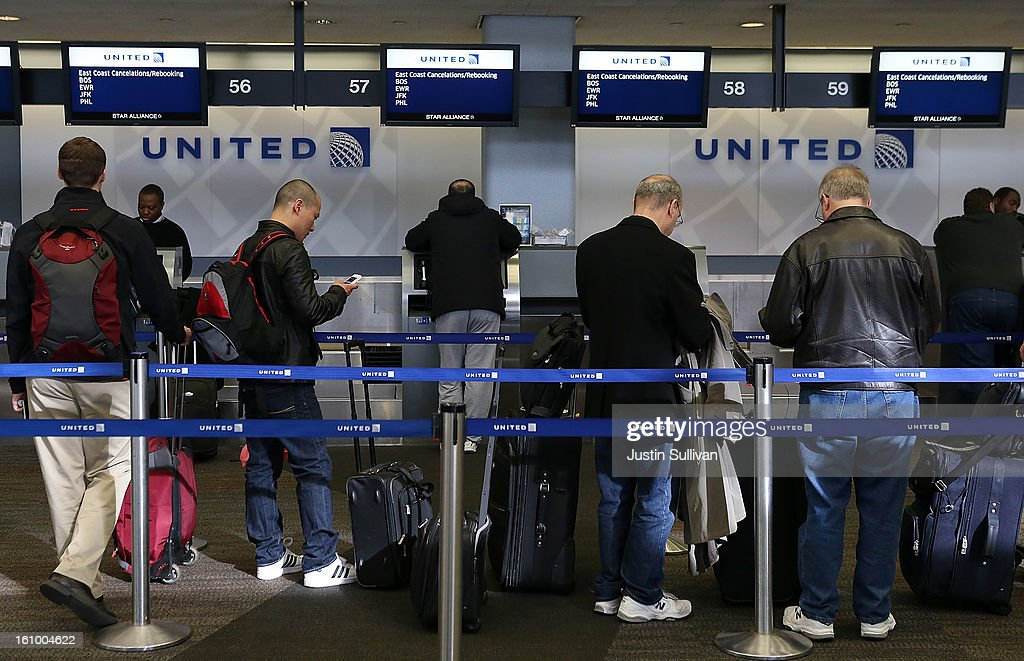 United Airlines passengers line up to rebook flights that were canceled due to weather on February 8, 2013 in San Francisco, California. Thousands of flights to the East Coast were canceled as a potentially historic blizzard is set to dump up to three feet of snow in the Northeast from New York City to Boston.