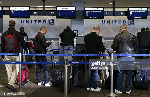 United Airlines passengers line up to rebook flights that were canceled due to weather on February 8 2013 in San Francisco California Thousands of...