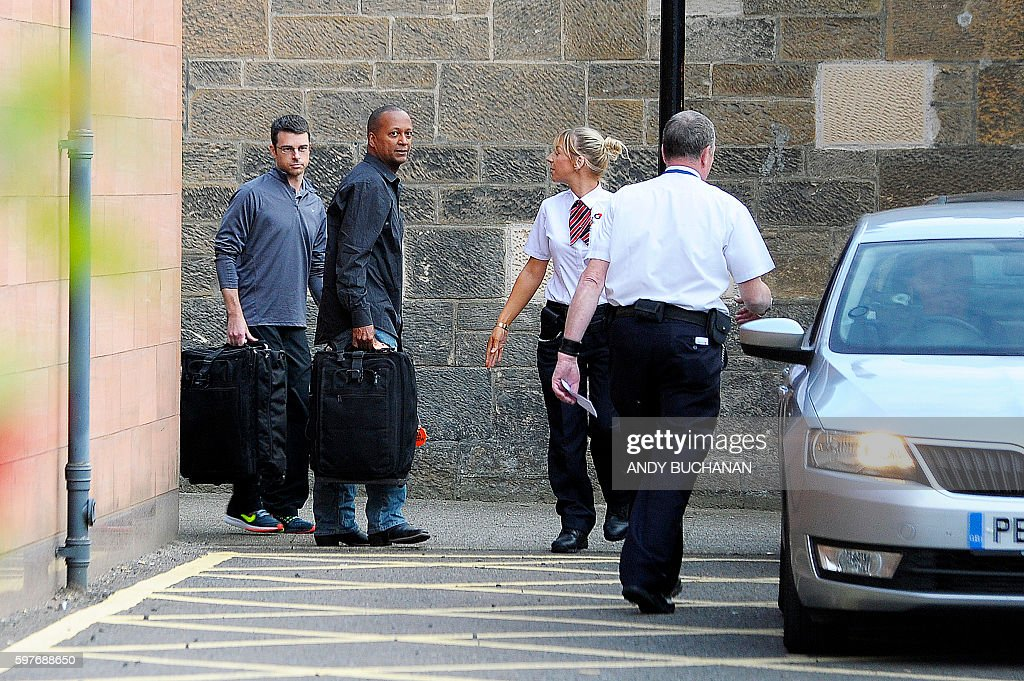 United Airlines pilots Brady Grebenc and Carlos Licona are pictured as they leave Paisley Sherrif Court in Glasgow after being freed on bail on...