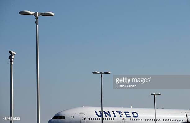 United Airlines plane sits on the tarmac at San Francisco International Airport on January 23 2014 in San Francisco California United Airlines parent...