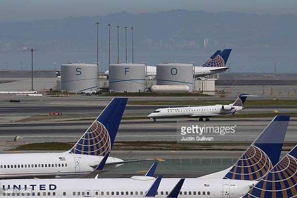 United Airlines plane taxis on the runway at San Francisco International Airport on March 13 2015 in San Francisco California According to a...