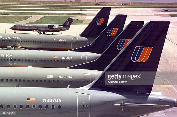 United Airlines planes are lined up near the terminal June 22 2001 at the Denver International Airport in Denver Colorado Shares of United Airlines'...
