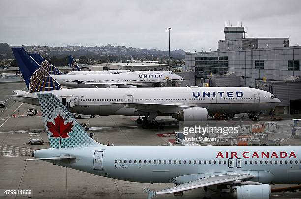 United Airlines planes sit on the tarmac at San Francisco International Airport on July 8 2015 in San Francisco California Thousands of United...