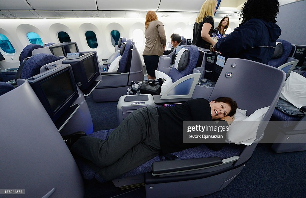 United Airlines sales manager Marilyn Jablonsky tries the new reclining Business First class seats on the new Boeing 787 Dreamliner during a tour of the jet at Los Angeles International Airport on November 30, 2012 in Los Angeles, California. In January the new jet is scheduled to begin flying daily non-stop between Los Angeles International airport and Japan's Narita International Airport and later to Shanghai staring in March. The new Boeing 787 Dreamliner will accommodate 219 travelers with 36 seat in United Business First, 70 seats in Economy Plus and 113 in Economy Class. The carbon-fiber composite material that makes up more than 50 percent of the 787 makes the plane jet and more fuel-efficient.