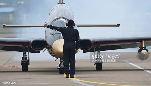 A United Arab 1st Aerobatic Team jet is given direction before performing in their MB339A during the Airshow China 2010 in Zhuhai south China's...