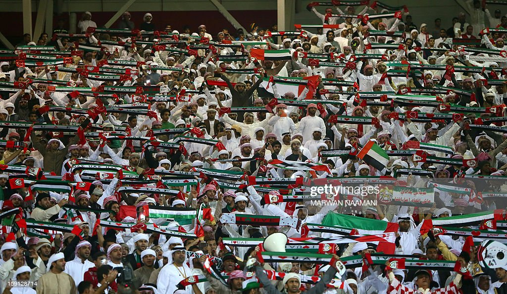 United Arab Emirate fans cheer their team against Bahrain in the 21st Gulf Cup in Manama, on January 8, 2013. The Emiartes won 2-1.