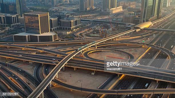 United Arab Emirates, Dubai, Aerial view of Sheikh Zayed Road and metro