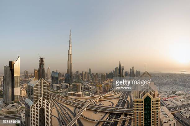 United Arab Emirates, Dubai City, Interchange at Sheikh Zayed Road with the Burj Khalifa at sunset