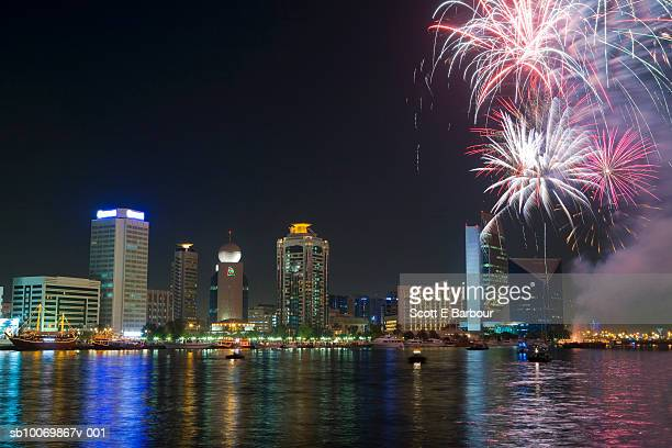 United Arab Emirates, Dubai, fireworks over skyline at night