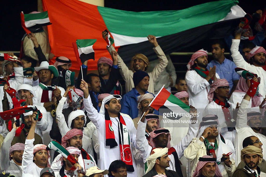 United Arab Emirates fans support their national team during their football match against Qatar in the 21st Gulf Cup in Manama, on January 5, 2013.
