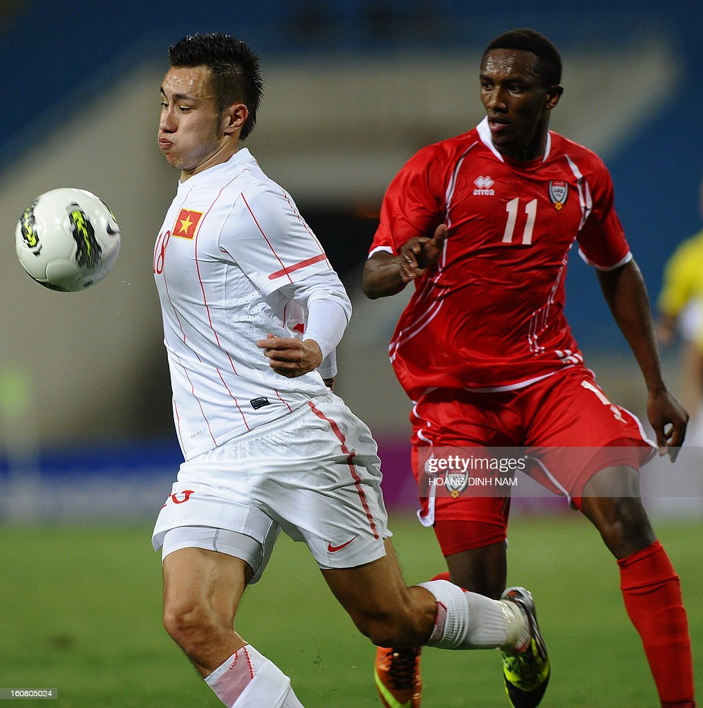 United Arab Emirates footballer Ahmed Khalil (R) fights for the ball with Vietnam midfielder Michal Nguyen during the Asian Cup 2015 qualifying match Vietnam vs UAE in Hanoi on February 6, 2013. UAE won 2-1. AFP PHOTO/HOANG DINH Nam
