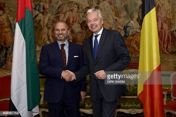 United Arab Emirates Foreign Secretary Anwar Gargash shakes hands with Belgian Vice Prime Minister and Foreign Minister Didier Reynders on November 4...