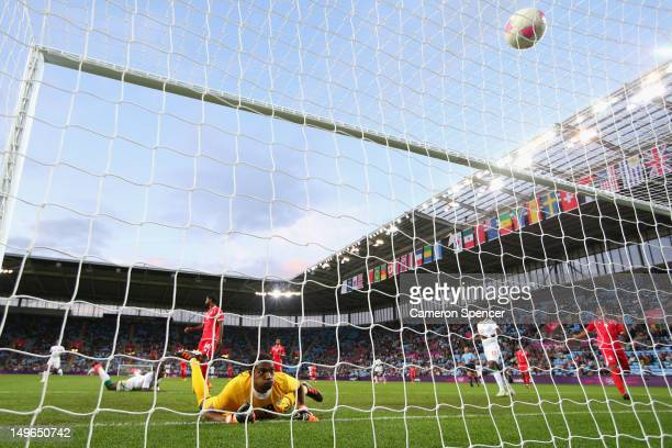 United Arab Emirates goalkeeper Khalid Eisa watches the ball cross the line as Moussa Konate of Senegal scores during the Men's Football first round...