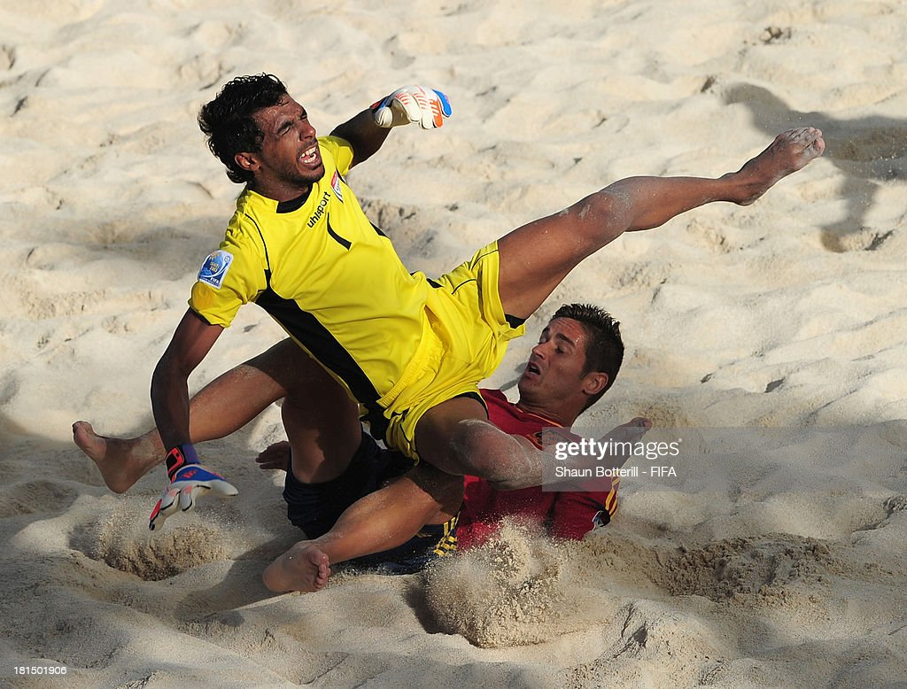 United Arab Emirates goalkeeper Mohamed Aljasmi is tackled by Raul Merida of Spain during the FIFA Beach Soccer World Cup Tahiti 2013 Group A match between United Arab Emirates and Spain at the Tahua To'ata stadium on September 21, 2013 in Papeete, French Polynesia.
