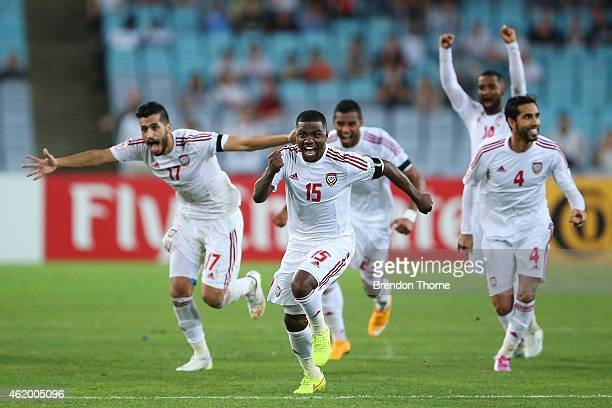 United Arab Emirates players celebrate after winning in a penalty shoot out during the 2015 Asian Cup Quarter Final match between Japan and the...