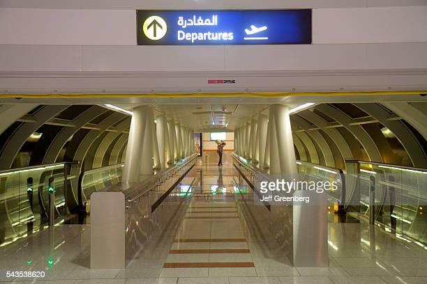 United Arab Emirates UAE UAE Middle East Dubai International Airport concourse terminal English Arabic language sign departures moving walkway