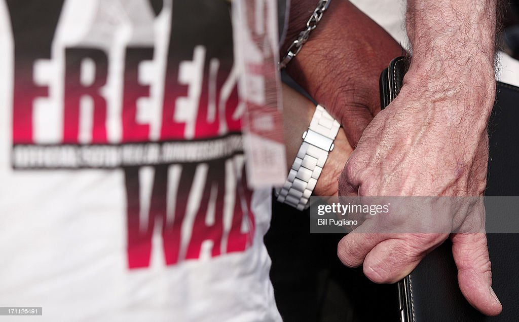 DETROIT, MI - United Auto Workers President Bob King (right) holds hands with a fellow marcher during a prayer at a press conference before the start of the 50th Anniversary Commemorative Freedom Walk June 22, 2013 in Detroit, Michigan. The march commerates the 50th anniversary of Dr. Martin Luther King's Walk To Freedom.