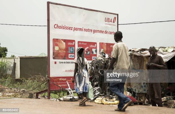 A United Bank for Africa Plc advertisement for Visa Inc bankcards stands near shacks in N'Djamena Chad on Tuesday Aug 15 2017 African Development...