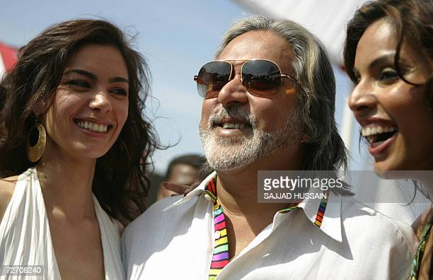 United Breweries group chairman Vijay Mallaya poses with calendar models during the launch of the 'Kingfisher Swimsuit Special Calendar 2007' in...