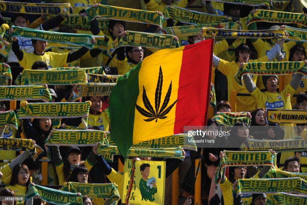 JEF United Chiba supporters hold mufflers and wave the flag during the pre season friendly between Kashiwa Reysol and JEF United Chiba at Hitachi Kashiwa Soccer Stadium on February 17, 2013 in Kashiwa, Japan.