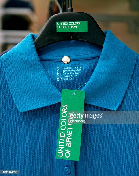 A United Colors of Benetton clothes tag sits on a polo shirt inside a Benetton Group SpA store in Rome Italy on Wednesday Feb 1 2012 The Benetton...