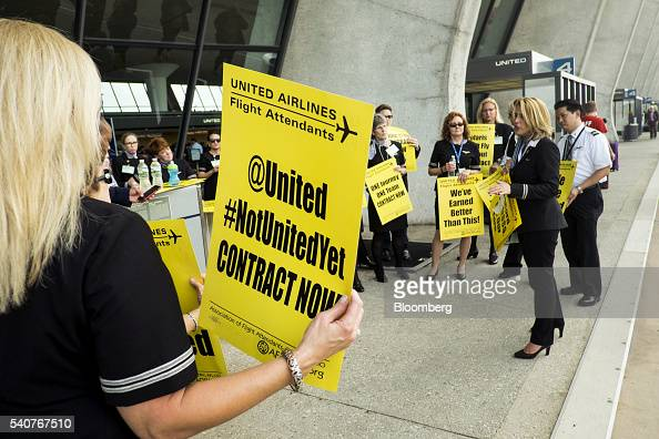 United Continental Holdings Inc flight attendants picket for a new contract at Dulles International Airport in Dulles Virginia US on Thursday June 16...