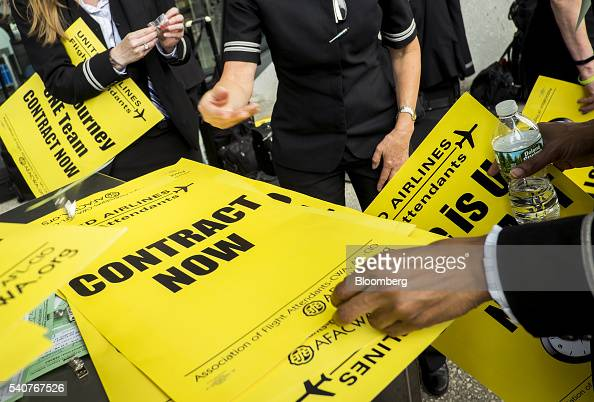 United Continental Holdings Inc flight attendants take signs while picketing for a new contract at Dulles International Airport in Dulles Virginia US...