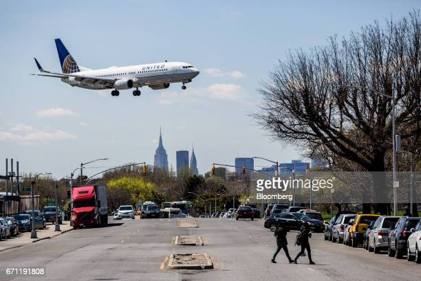 A United Continental Holdings Inc plane prepares for landing at LaGuardia Airport in New York US on Tuesday April 18 2017 An additional section of...