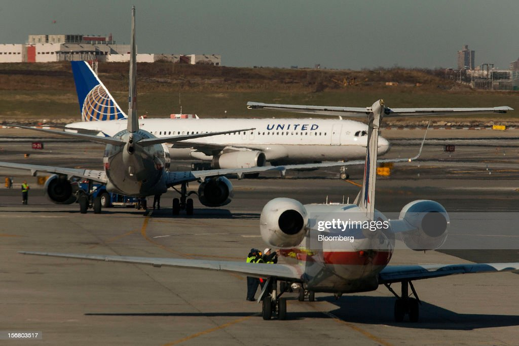 A United Continental Holdings plane taxis past other jets on the runway at LaGuardia Airport in the Queens borough of New York, U.S., on Wednesday, Nov. 21, 2012. U.S. travel during the Thanksgiving holiday weekend will rise a fourth straight year, gaining 0.7 percent from 2011, as trips by automobile rise even as airplane trips decline, AAA said last week. Photographer: Michael Nagle/Bloomberg via Getty Images